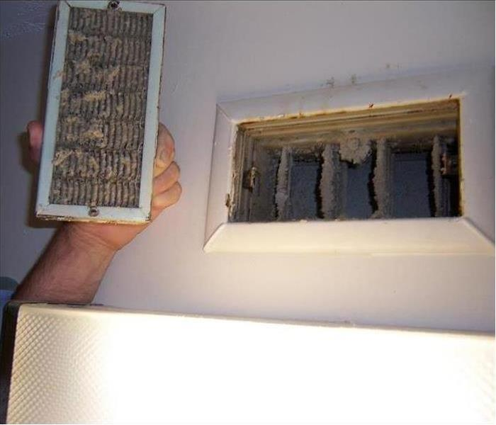 Dirty HVAC vent and grill.